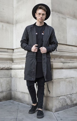 How to Wear Black Jeans For Men: For casual street style without the need to sacrifice on comfort, we love this pairing of a black raincoat and black jeans. The whole outfit comes together when you introduce black canvas low top sneakers to the mix.