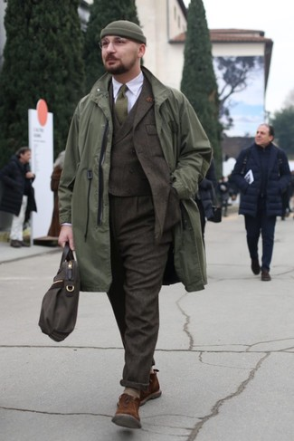 How to wear: olive raincoat, dark brown wool three piece suit, white dress shirt, brown suede desert boots