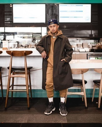 Navy Baseball Cap Outfits For Men: Consider teaming a dark brown check raincoat with a navy baseball cap for head-to-toe comfort dressing. Complement your look with dark brown athletic shoes to change things up a bit.