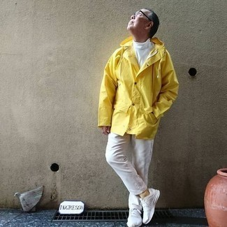 Mustard Raincoat with Pants Outfits For Men: A mustard raincoat and pants worn together are a match made in heaven for gentlemen who prefer casual looks. Let your styling skills really shine by rounding off this getup with a pair of white athletic shoes.