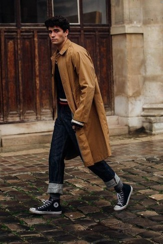Black and White Canvas High Top Sneakers Outfits For Men: Look sharp yet off-duty in a tobacco raincoat and navy jeans. Complete your outfit with a pair of black and white canvas high top sneakers to keep the look fresh.