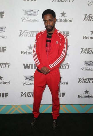 How to wear: red and black print crew-neck t-shirt, red track suit, black embroidered leather loafers