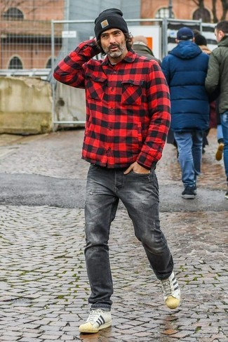 How to wear: red and black check shirt jacket, charcoal jeans, beige leather low top sneakers, black beanie