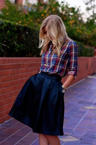 How to Wear a Navy Full Skirt: Demonstrate your styling skills by teaming a red and navy plaid dress shirt and a navy full skirt for a casual outfit.