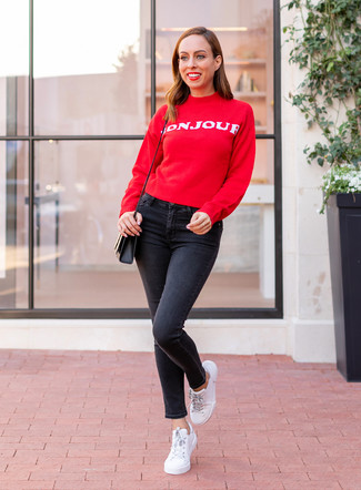 How to wear: red and white print crew-neck sweater, black skinny jeans, white leather low top sneakers, black leather crossbody bag