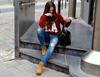 If you love staying-in clothes which are stylish enough to wear out, try this combination of a red and white print crew-neck sweater and blue ripped skinny jeans. This look is complemented perfectly with tan suede lace-up flat boots. You can bet this outfit is the answer to all of your fall style woes.