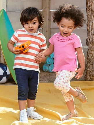 Boys' Looks & Outfits: What To Wear In Summer: Consider dressing your tot in a red and white horizontal striped t-shirt with navy denim shorts for a fun day in the park. As far as footwear is concerned, suggest that your tot choose a pair of white sneakers.