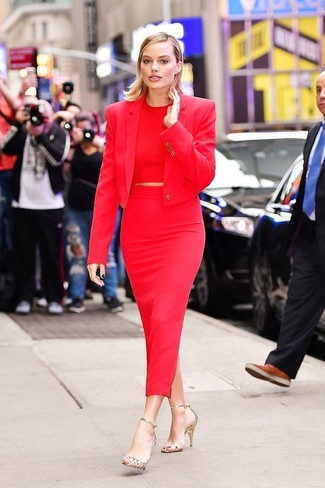 Women's Looks & Outfits: What To Wear In 2020: For an off-duty ensemble, marry a red blazer with a red midi skirt — these two items fit really well together. We adore how a pair of gold leather heeled sandals makes this look whole.