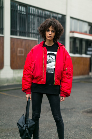 How to wear: red bomber jacket, black and white print crew-neck sweater, black leather leggings, black leather tote bag