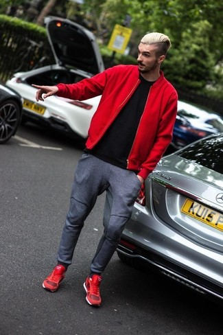 How to Wear a Red Bomber Jacket For Men: Want to inject your closet with some relaxed dapperness? Choose a red bomber jacket and charcoal sweatpants. Let your sartorial skills truly shine by rounding off your look with a pair of red athletic shoes.