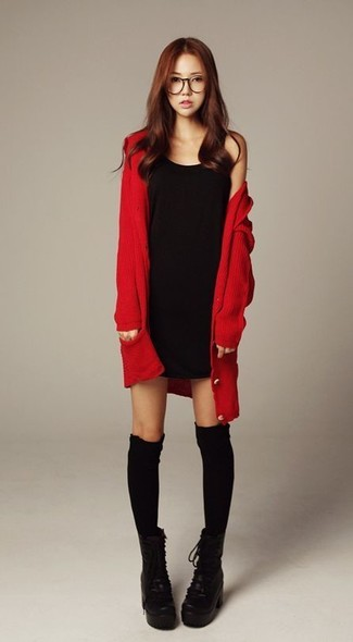 Consider teaming a red cardigan with a black tank dress for an effortless kind of elegance. Black chunky leather lace-up ankle boots will add elegance to an otherwise simple look.