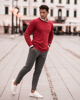 How to wear: red crew-neck sweater, white long sleeve shirt, grey chinos, white leather low top sneakers