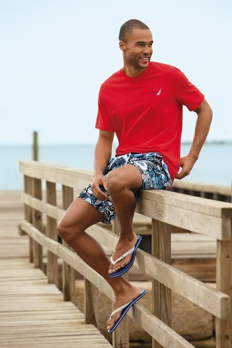 How to wear: red crew-neck t-shirt, blue floral shorts, white and navy flip flops