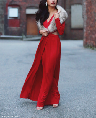 For a nothing less than drool-worthy ensemble, make a red cutout evening dress your outfit choice. A pair of beige leather heeled sandals will integrate smoothly within a variety of looks. You can bet this outfit is the answer to all of your transitional style problems.