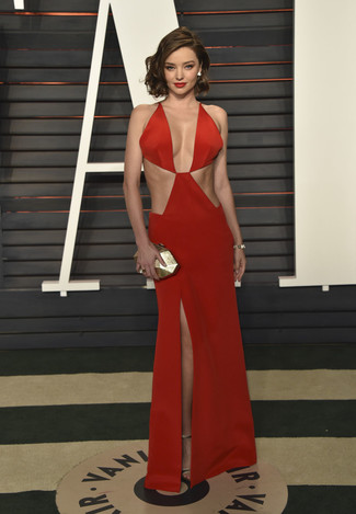 Miranda Kerr wearing Red Cutout Evening Dress, Gold Leather Heeled Sandals, Gold Clutch, Gold Bracelet