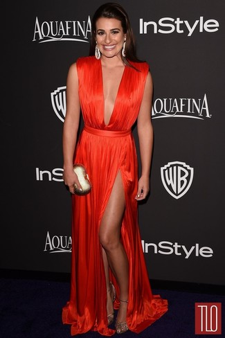 Lea Michele wearing Red Pleated Evening Dress, Gold Leather Heeled Sandals, Gold Clutch, Silver Earrings