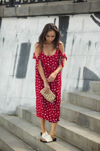 Reach for a red floral midi dress to create a chic, glamorous look. Want to go easy on the shoe front? Throw in a pair of white leather flat sandals for the day.