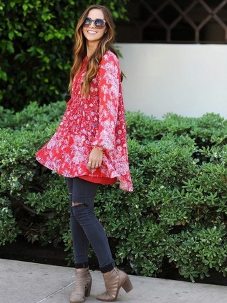 How to wear: red floral swing dress, charcoal ripped skinny jeans, grey cutout leather ankle boots