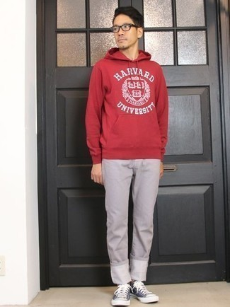 How to Wear a Red Print Hoodie For Men: Pair a red print hoodie with grey chinos if you seek to look neat and relaxed without putting in too much time. Navy and white canvas low top sneakers are the right footwear here.