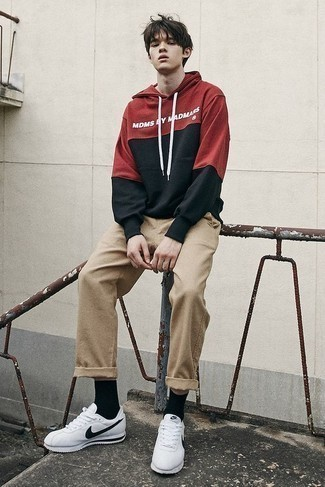 500+ Outfits For Men In Their Teens: A red print hoodie looks so good when worn with khaki chinos. To give your overall look a more casual aesthetic, complement your ensemble with white and black athletic shoes. This ensemble demonstrates that as a teenage boy, you have a wide range of style options.