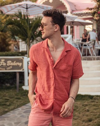 How to wear: red linen short sleeve shirt, hot pink shorts, brown sunglasses