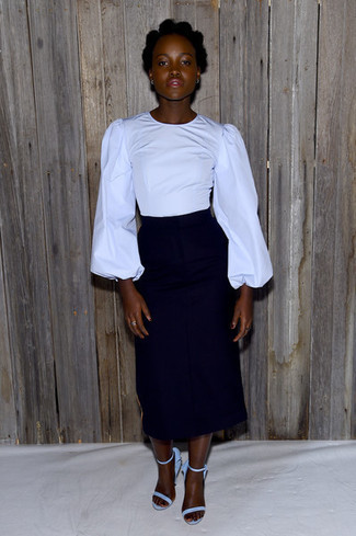 We give a huge thumbs up to this pairing of a red long sleeve blouse and a black midi skirt! A pair of light blue suede heeled sandals will integrate smoothly within a variety of ensembles. This combo is perfect when it's extremely hot outside.