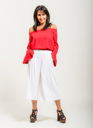 How to Wear White Culottes: Make a red off shoulder top and white culottes your outfit choice to get a laid-back and practical getup. If you want to instantly spruce up your look with one item, complete this ensemble with a pair of black chunky leather heeled sandals.