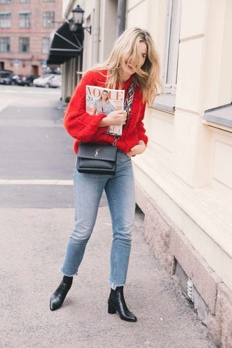 How to wear: red knit oversized sweater, light blue skinny jeans, black leather ankle boots, black leather crossbody bag