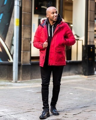 Men's Outfits 2020: This pairing of a red parka and black jeans is proof that a safe casual ensemble can still be incredibly dapper. Go ahead and complete this look with a pair of black leather desert boots for an extra dose of polish.