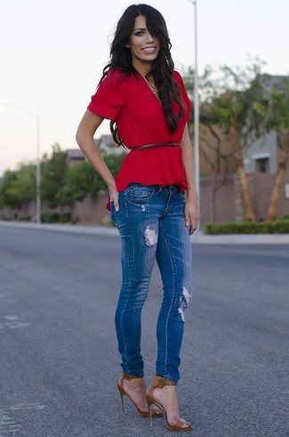 A red peplum top and blue ripped skinny jeans is a good combo to impress your crush on a date night. Olive leather heeled sandals will add elegance to an otherwise simple look. Seeing as it's boiling hot outside, this outfit seems ideal and entirely season-appropriate.