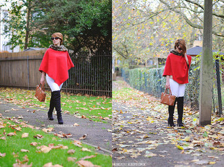 A red poncho and white jeans are a great outfit formula to have in your arsenal. For footwear go down the classic route with black suede over the knee boots.