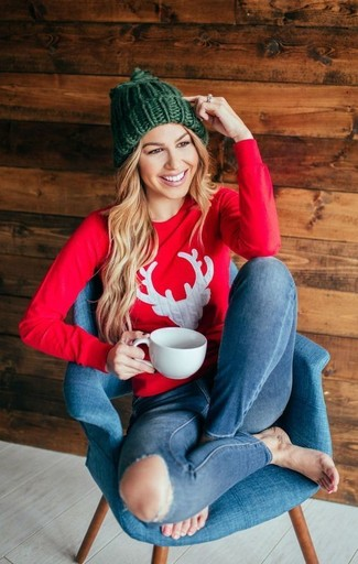 How to wear: red print sweatshirt, blue ripped skinny jeans, green knit beanie