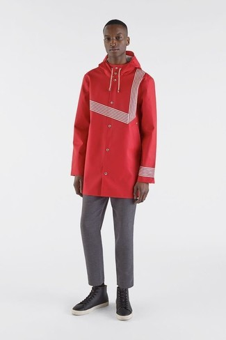 How to wear: red raincoat, grey chinos, black leather high top sneakers