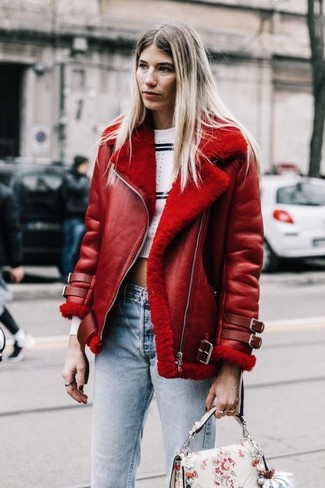 How to wear: red shearling jacket, white and black horizontal striped cropped sweater, light blue jeans, white floral leather satchel bag