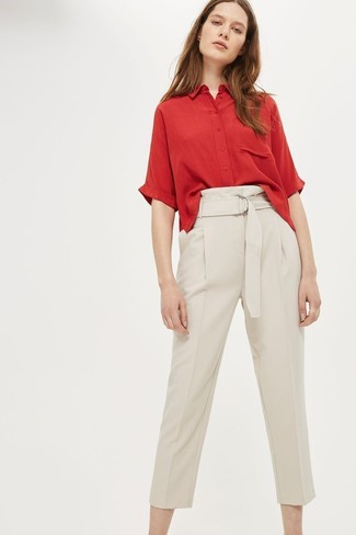 How to wear: red short sleeve button down shirt, beige tapered pants