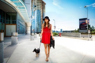 Pair a red skater dress with a black hat to effortlessly deal with whatever this day throws at you. To bring out a sassier side of you, complete your look with black leather gladiator sandals. No doubt, it's easier to work through a summertime afternoon in a breezy outfit such as this one.