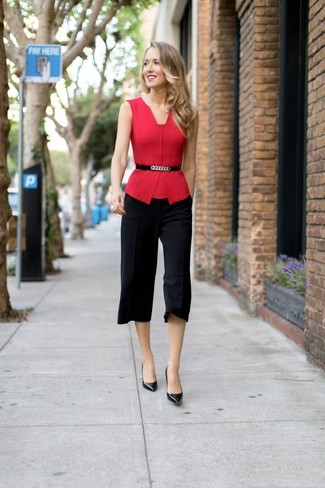 Reach for a red sleeveless top and black culottes for a standout ensemble. Elevate your getup with black leather pumps.