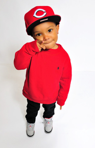 How to Wear Charcoal Sneakers Smart Casually For Boys: For an everyday outfit that is full of character and personality suggest that your little one wear a red sweater with black trousers. Finish off this outfit with charcoal sneakers.