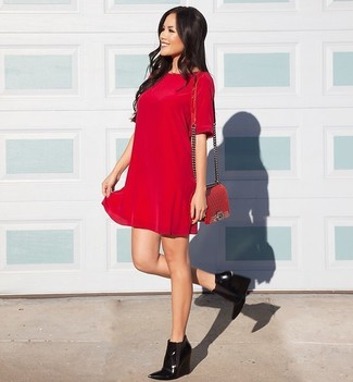 Show off your sophisticated side in a red velvet shift dress and a red quilted leather crossbody bag. A pair of black leather wedge ankle boots ads edginess to a femme classic. We promise this outfit is the answer to all of your fall style struggles.