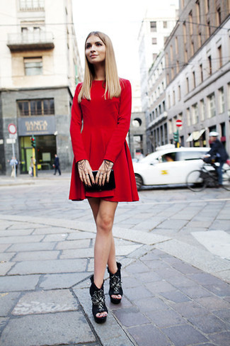 Choose a red velvet skater dress for a comfortable outfit that's also put together nicely. A cool pair of black chunky suede ankle boots is an easy way to upgrade your look. This outfit is a great pick if you're looking for an easy-to-transition getup.