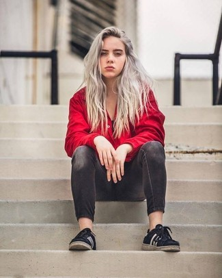 Black Low Top Sneakers Outfits For Women: Busy off-duty days call for a straightforward yet chic ensemble, such as a red windbreaker and charcoal skinny jeans. Add a pair of black low top sneakers to the equation to pull the whole ensemble together.