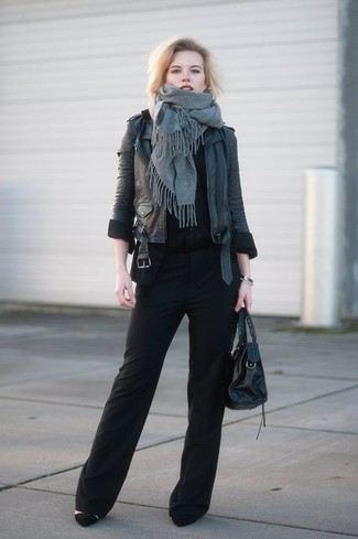 How to wear: grey shawl, black leather biker jacket, black crew-neck t-shirt, black wide leg pants