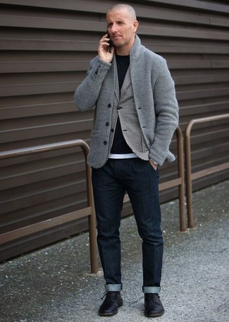 How to Wear a White Tank For Men: This combo of a white tank and navy jeans spells comfort and style. Infuse this ensemble with an added dose of class by rocking a pair of black leather derby shoes.