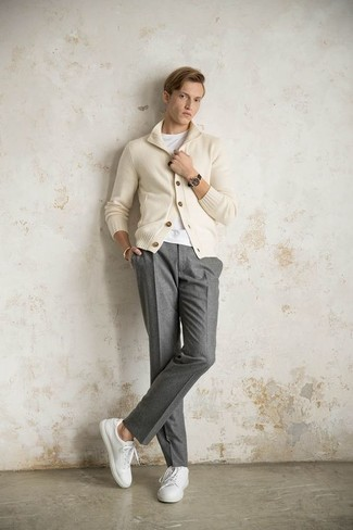 How to Wear a Black Leather Watch In Your 20s For Men: Pair a beige shawl cardigan with a black leather watch for a relaxed casual look with a twist. To bring a bit of zing to this ensemble, introduce white leather low top sneakers to the mix.