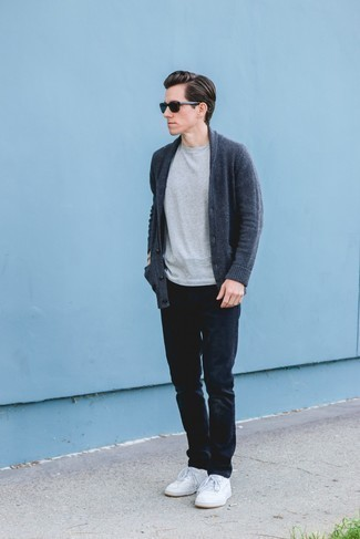 Men's Looks & Outfits: What To Wear In 2020: This combination of a navy shawl cardigan and navy jeans looks pulled together and makes any guy look instantly cooler. A pair of white leather low top sneakers effortlesslly turns up the wow factor of your look.