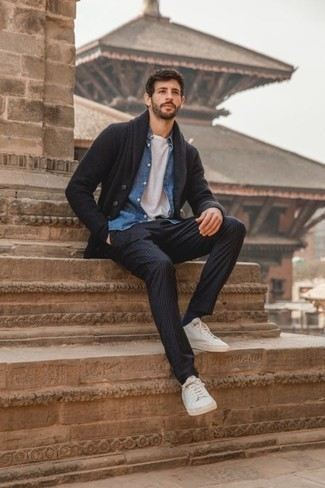 Low Top Sneakers Outfits For Men: For something on the cool and laid-back side, go for a charcoal shawl cardigan and navy vertical striped chinos. Throw low top sneakers into the mix to keep the look fresh.
