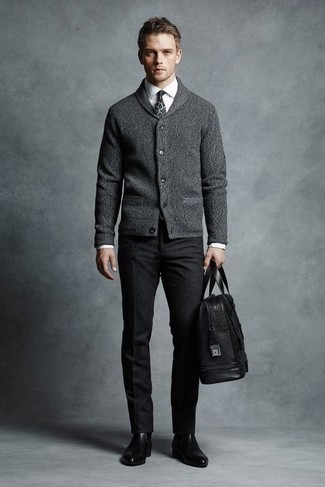 How to Wear a Black Leather Holdall For Men: For a tested laid-back option, you can rely on this combination of a grey shawl cardigan and a black leather holdall. Lift up your ensemble with black leather chelsea boots.