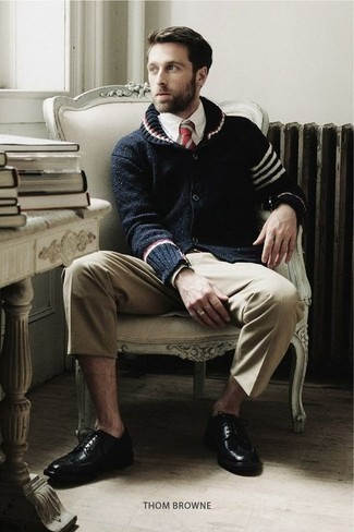 How to Wear Beige Chinos: If the dress code calls for a casually neat ensemble, you can opt for a navy shawl cardigan and beige chinos. To introduce a little zing to this outfit, throw a pair of black leather brogues in the mix. As a young gent, you probably want to start dressing like a grown-up. In this case, ensembles like this come in useful.