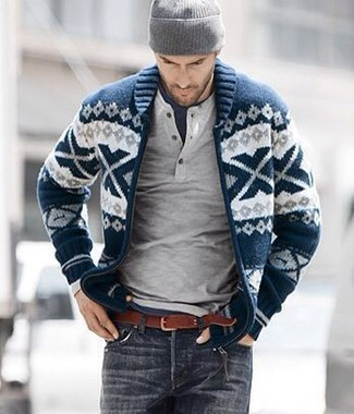 How to wear: navy and white fair isle shawl cardigan, grey henley sweater, navy crew-neck t-shirt, charcoal jeans