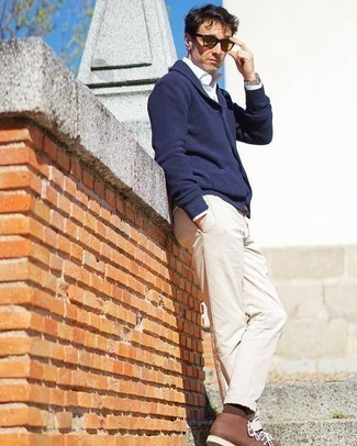 How to Wear Yellow Sunglasses For Men: A navy shawl cardigan and yellow sunglasses have become an essential off-duty combination for many fashion-savvy men. Why not complete your ensemble with brown leather desert boots for an added touch of style?